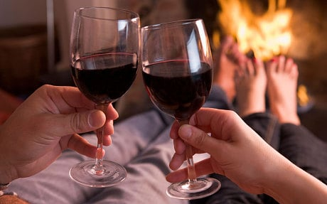 People drinking red wine