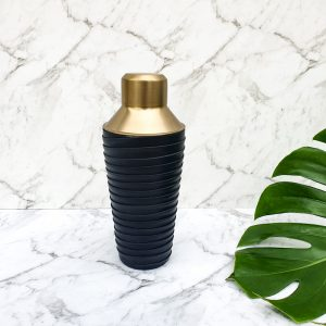 brass and leather cocktail shaker